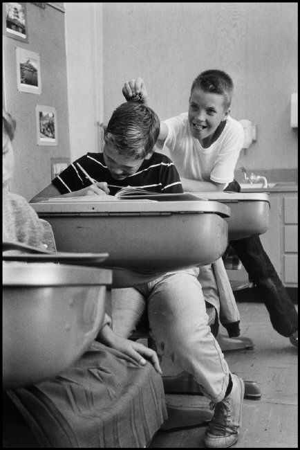 Wayne Miller - USA, 1956 | classroom | vintage | school desk | teasing | bully | black & white photography | naughty | cheeky | bulling | nerd | elementary | primary | | www.republicofyou.com.au