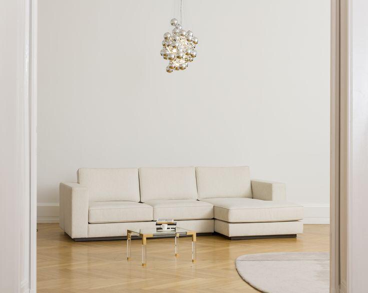 Milano Chaise Sofa by MOMOS Studio Shown in ivory API Light: Stochastic / Luceplan Table: Jonathan Adler Rug: Normann Copenhagen