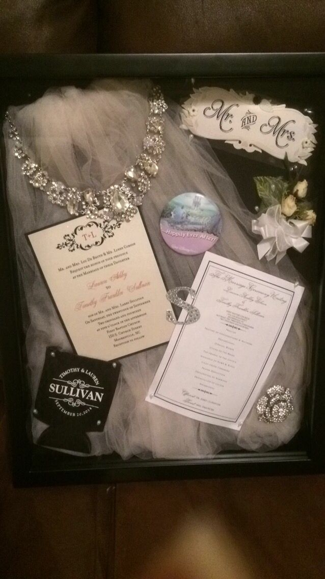 Wedding shadow box 2014 Brides veil, necklace, invite, program, disney honeymoon pin, grooms flower, the brooch from the cake I made this very easy!!! Mrs. Lauren Sullivan