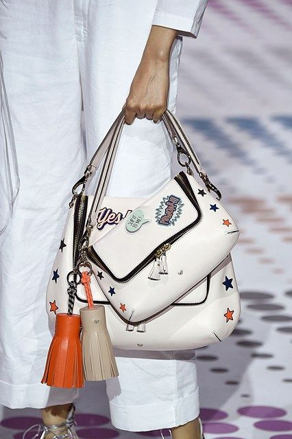 Yes! Power - This season's theme was school girl customisation, Anya's childhood habit for sticking stickers on her school books was immortalised in leather; has accessorising your bag with stickers it seems have knocked the fluffy bag bug off the trend top spot next season? spring/summer 2015 16 SEPTEMBER 2014 Laura Weir for Vogue