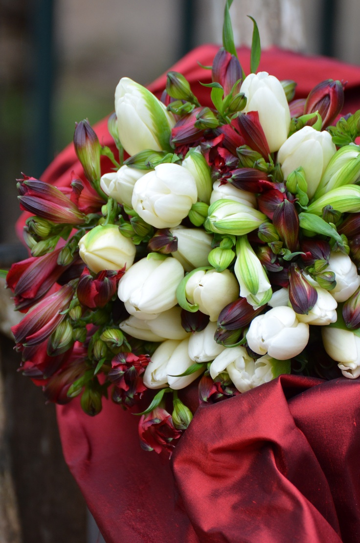 Bridesmaids bouquet .The red peruvian lilies match their dresses.