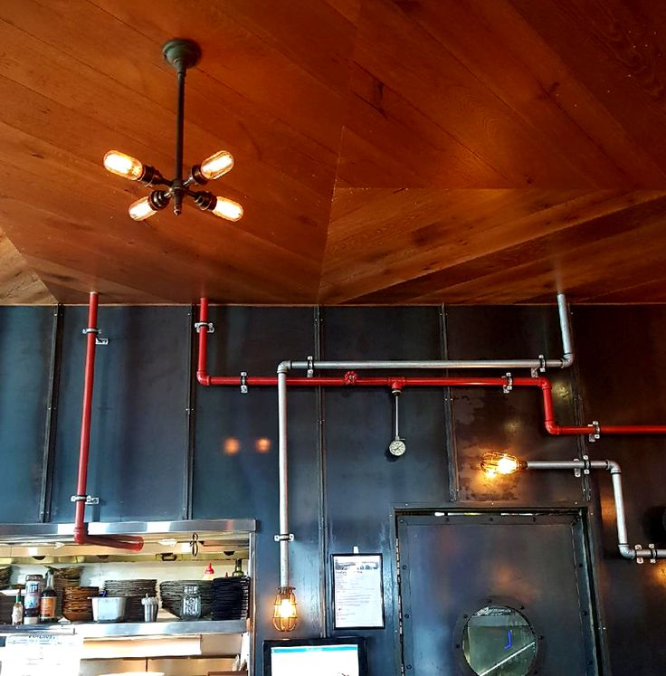 Our brass four bulb pendant insitu at the Loose Moose.