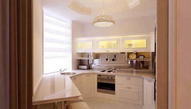 Компактная кухня с раковиной у окна.    Compact kitchen with sink at the window