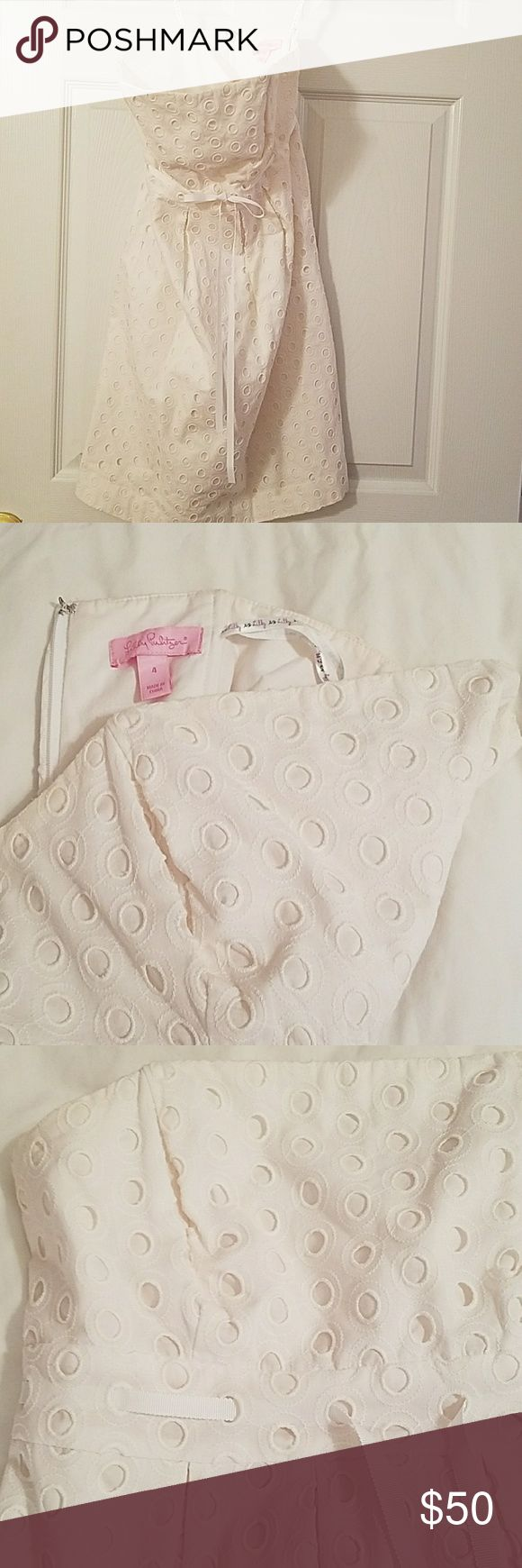 Lilly Pulitzer Dress White eyelet Lilly Pulitzer Dress - Size 4  Cotton dress fully lined, back zipper closure, boning in bodice  Small, faint stain on front and one of looks foe hanging the dress is torn   Smoke free home Lilly Pulitzer Dresses Strapless