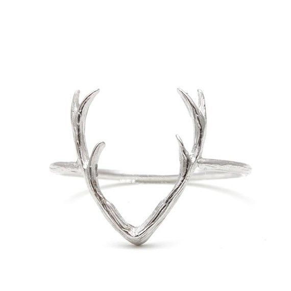Beautifully HAND-CRAFTED, this delicate women's antler ring is sure to impress. In your choice of 18KT Gold, Rose Gold and Sterling Silver, this ring is available in size 6.5US. Whether you want to dr