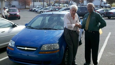 Folger Subaru Sales Consultant Bill Barber with Mr. Stark and his 2005 Chevy Aveo!