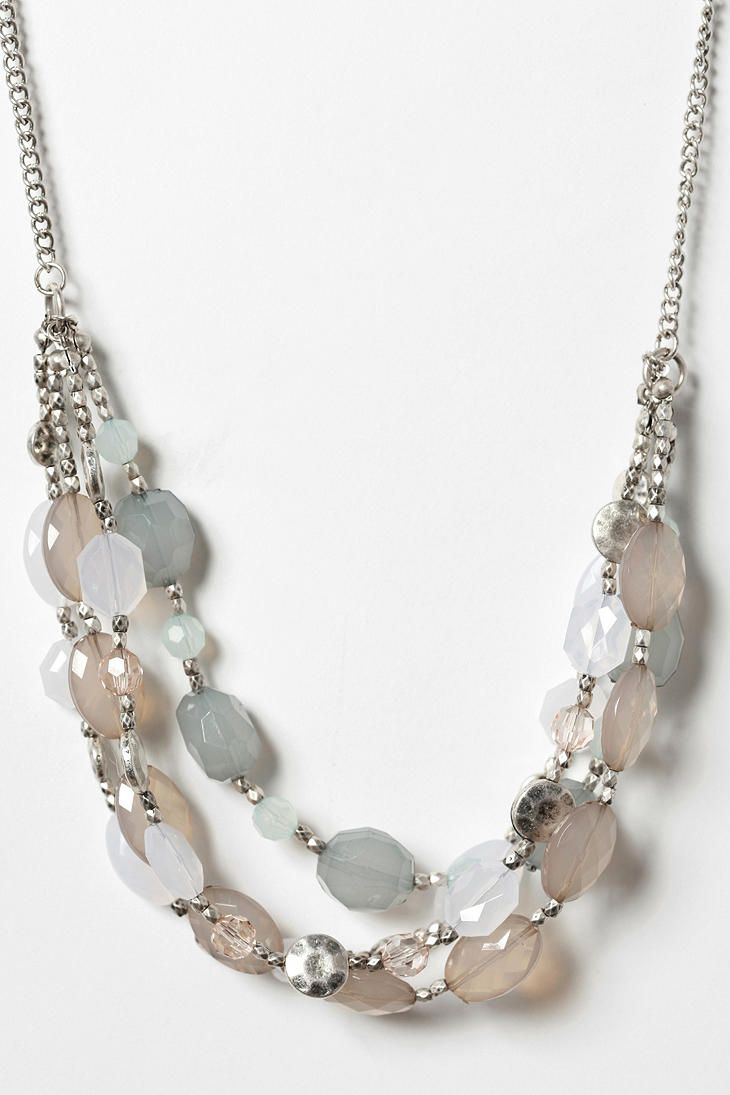 Multi-strand beaded necklace with mixed pastel beads. Love the silver nugget beads leading up to the chain.