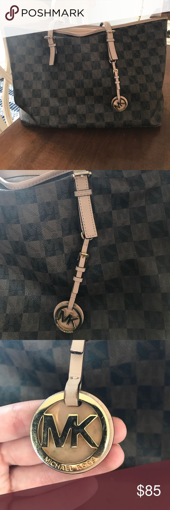 Michael Kors checkered bag Authentic Mk brown checkered bag (similar to lv neverfull) one stain on inside bag. Stain on mk hanging chain as pictured. Leather is aging on handles and around top rim of bag. Michael Kors Bags Shoulder Bags