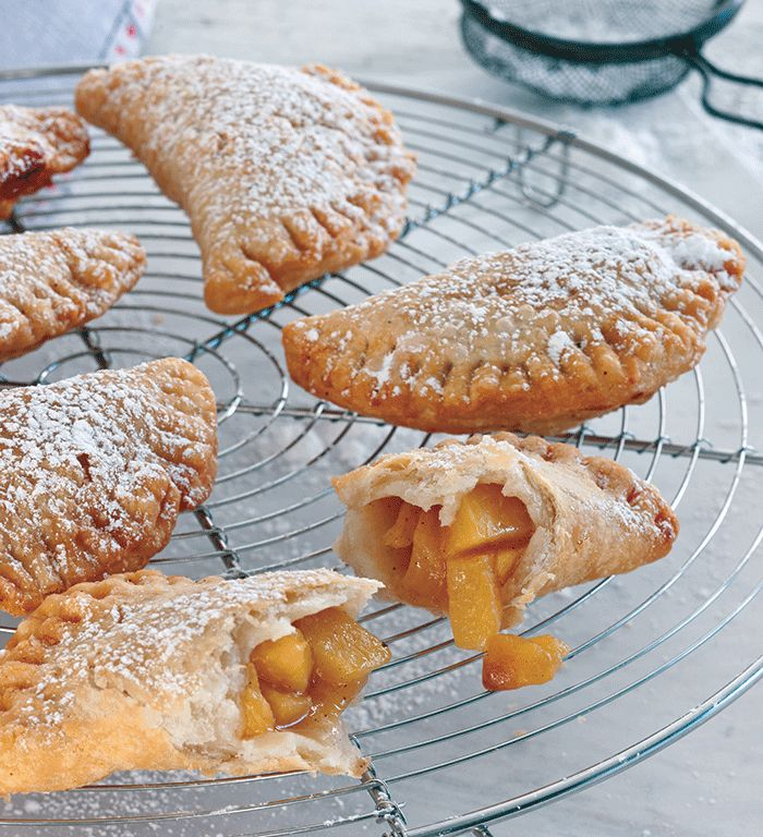 Fried Peach Pies Recipe  DOUGH 2 c. plus 2 T flour 2 1⁄2 tsp conf. sugar 3⁄4 tsp salt 4 T cold unsalted butter, diced 4 T cold lard, diced 1⁄2 c. ice water FILLING 4 large fresh peaches, peeled, pitted, & finely chopped 1⁄2 c. firmly packed light brown sugar 2 T butter 1 tsp vanilla extract 1⁄8 tsp ground cinnamon 1⁄8 tsp salt 1⁄8 tsp ground nutmeg Vegetable oil for frying Garnish: confectioners' sugar