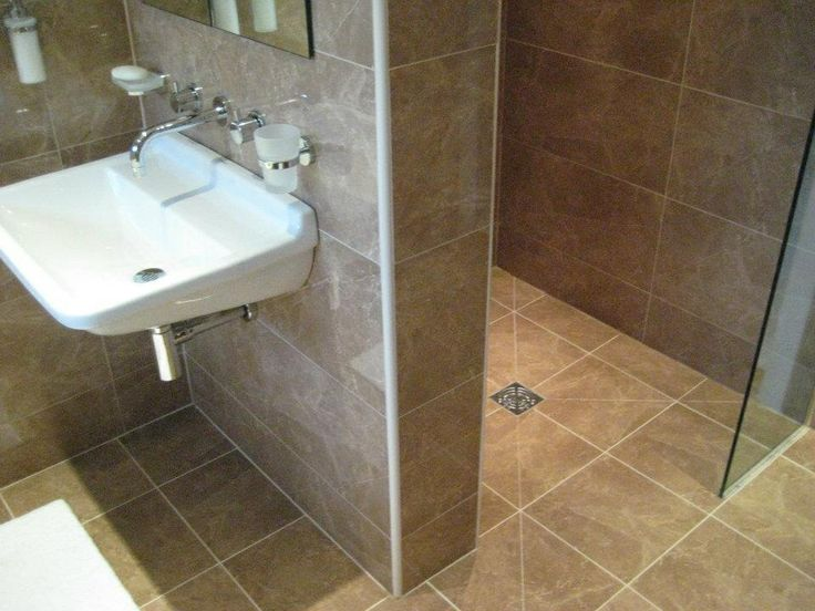 Shower alcove with wet room floor