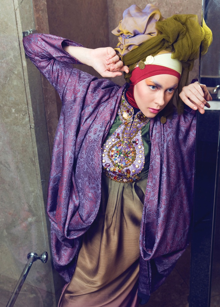Ombre silk and chiffon kaftan dress by Luire by Raden Sirait. Songket cocoon jacket and maroon Lycra inner hijab by Dian Pelangi. Olive tulle and chiffon metallic scarf from the Aquila Style wardrobe.