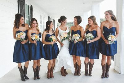 The bridesmaids looked chic in matching navy blue sweetheart dresses with cowboy boots.   Venue:Kendall Plantation   Dress Designer:Essense of AustraliafromSposa Mia Couture   Bridesmaid Dresses:Alfred...
