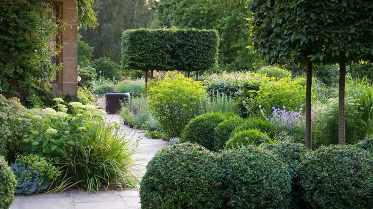 Gate House | Chris Moss Gardens, mix of shapes & textures in garden material, raised hedge