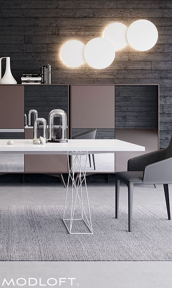 Destined to become the focal point of your dining space, this sculptural piece masterfully melds formidable form with functionality. Stainless wiry steel legs lend elegant contrast. Elegantly offered in Brazilian oak finishes or high gloss lacquers. Available in our Quick Ship program.