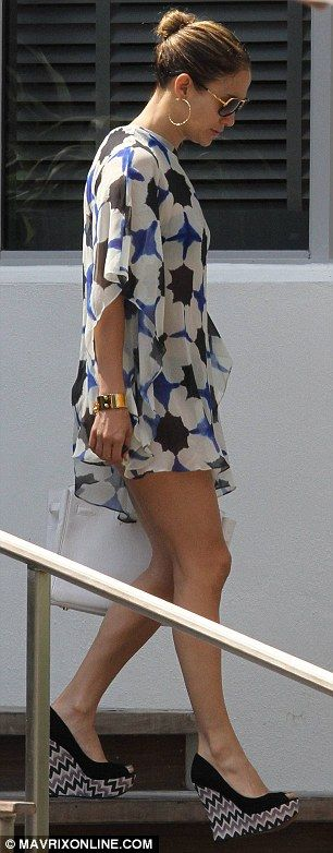 Now this is how you look arriving at the pool: wearing a retro-inspired kaftan and black wedges with zig-zag detailing on the heel, beautiful earrings, bangle, purse.  That's how it's done, Ms. JLo.