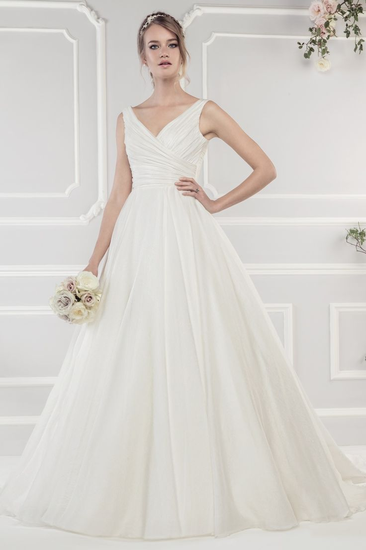 40 best ellis bridals images on pinterest wedding frocks ellis ellis bridals style 11427 offered at something white bridal boutique luxury organza ball gown with elegant cross over bodice and covered buttons running ombrellifo Gallery