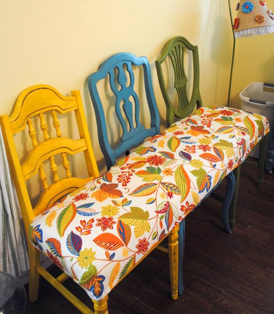 DIY Bench made with left over fabric. The seat is made from 2 king-sized pillows, so you don't even have to be an upholstery expert. Just find 3 chairs (make sure the seats are all the same height), a little paint, some fabric, and you're ready to go) #Upcycling #Clothes and #Ideas