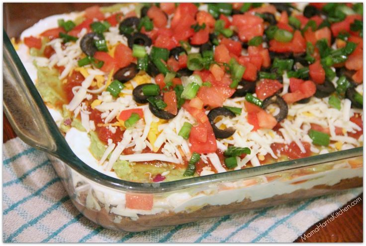 7-Layer Dip  I've made this for a party before and it was a total hit. Totally cheap too and serves a lot of people! You could serve it in a big bowl like the picture. -Nedia