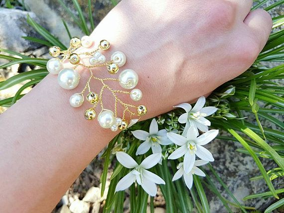 Check out this item in my Etsy shop https://www.etsy.com/listing/516781982/pearl-gold-bracelet-wire-jewelry-bridal