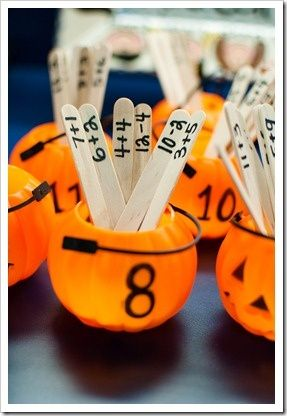 Halloween Math - addition facts using mini jack-o-lanterns.  I love that the popsicle sticks can be reused and put in any seasonal container.  Cute!