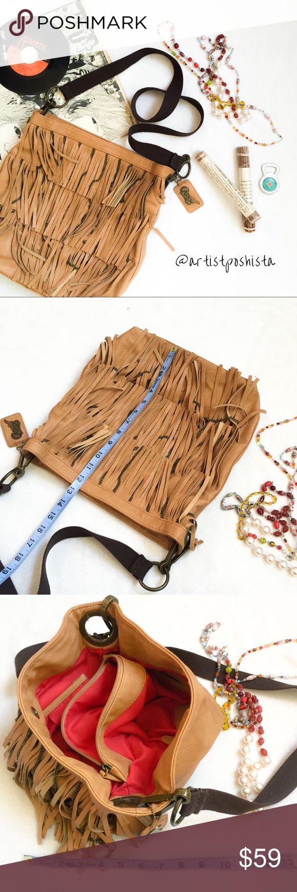 NWOT Rare Carlos Boho Fringe & Chain Xbody Bag Rare!!! Brand New w/ out Tags Carlos by Carlos Santana. Carmel/Tan color Vegan Leather Large Tour Style Bag w/ Boho Fringe & Chain detailing. No flaws, never used, completely pristine interior & exterior. Detachable crossbody or shoulder strap can be looped for a standard length purse strap or swapped out for a more personalized look. Stunningly gorgeous bag! Functional & well designed w/ inside pockets galore. Carlos Santana Bags Crossbody Bags