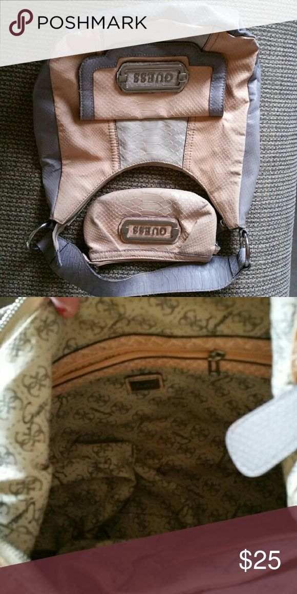 Guess Bag with coin purse Used quite a bit, still in very good condition. The coin purse is a bit dirty on the outside. Guess Bags