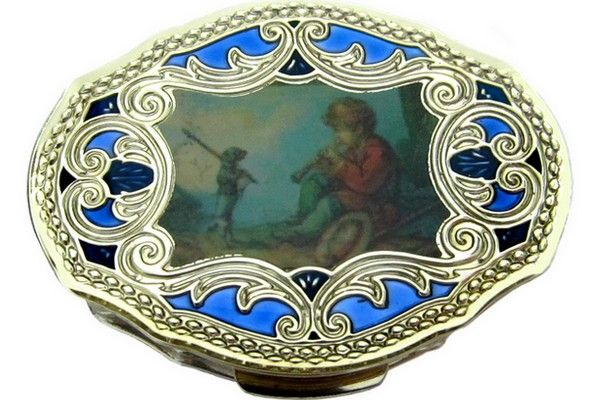 Silver pill-box titled 800/1000, hand enamelled with blue background and miniature of pastoral scene,  size cm. 5,7x4,2