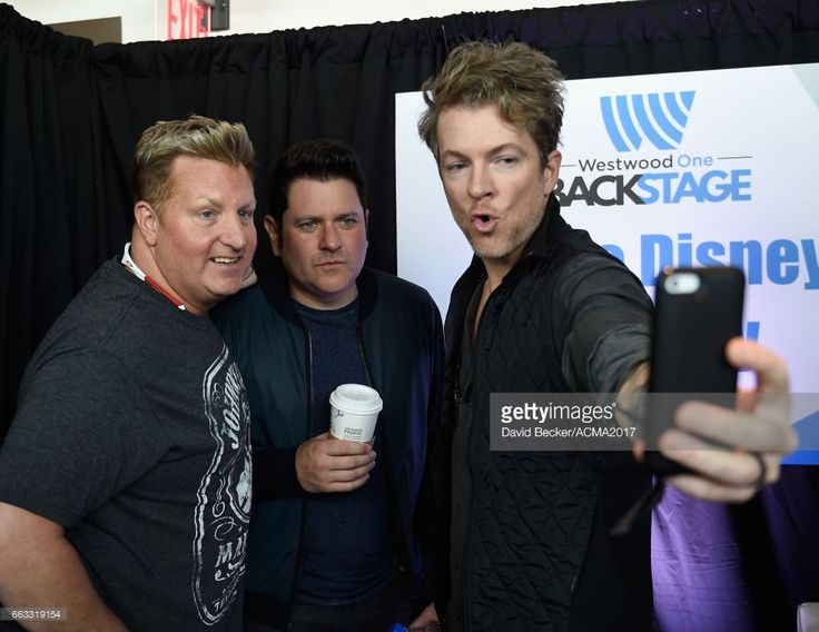 Musicians Gary LeVox, Jay DeMarcus, and Joe Don Rooney of Rascal Flatts pose for a selfie during the 52nd Academy Of Country Music Awards Cumulus/Westwood One Radio Remotes at T-Mobile Arena on April 1, 2017 in Las Vegas, Nevada.