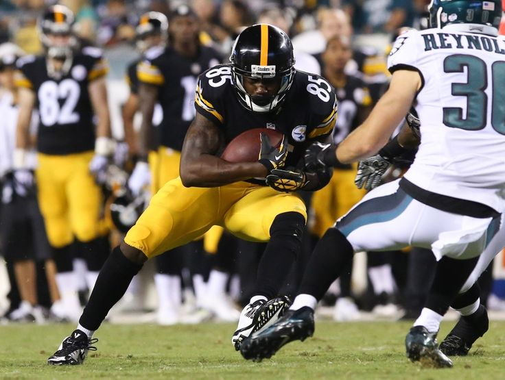 Aug 21, 2014; Philadelphia, PA, USA; Pittsburgh Steelers wide receiver Darrius Heyward-Bey (85) fakes out Philadelphia Eagles safety Ed Reynolds (30) on a run during the second half of a game at Lincoln Financial Field. The Eagles won 31-21. Mandatory Credit: Bill Streicher-USA TODAY Sports