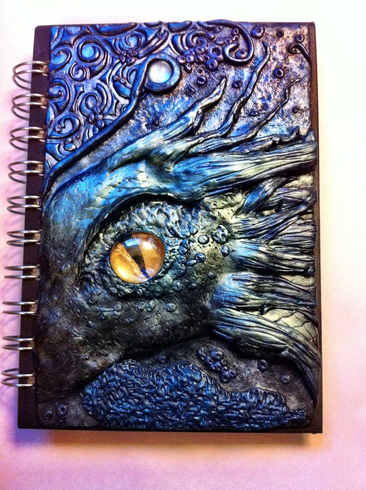 Handmade Polymer Clay Dragon Journal Cover. And the awesome thing, besides the incredible artistry and imagination, is that these covers are reusable! The possibilities are endless.
