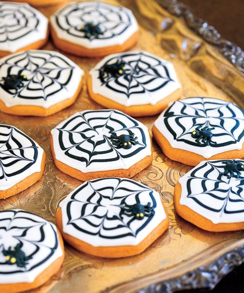 To conjure up a devilish-looking dessert, frost slice-and-bake sugar cookies with white royal icing. Then, starting at the cookie's center, pipe circles of black icing; create cobwebs by alternately dragging a toothpick from the center to the edge, and from the edge to the center.  - GoodHousekeeping.com