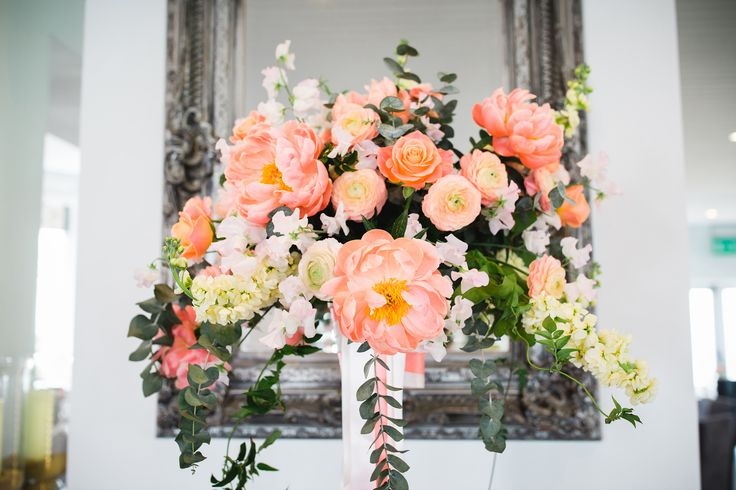 Flowerball pedestal of coral peonies, Stocks, Roses, Ranuculus, Eucalyptus by www.weddingflowersincornwall.co.uk photo by Toby Lowe photography