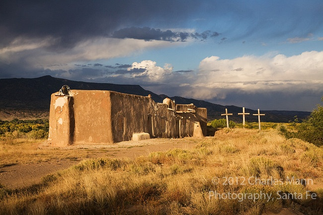 A morada, or Penitente chapel, sits on a hill about the village of Abiquiu, New Mexico