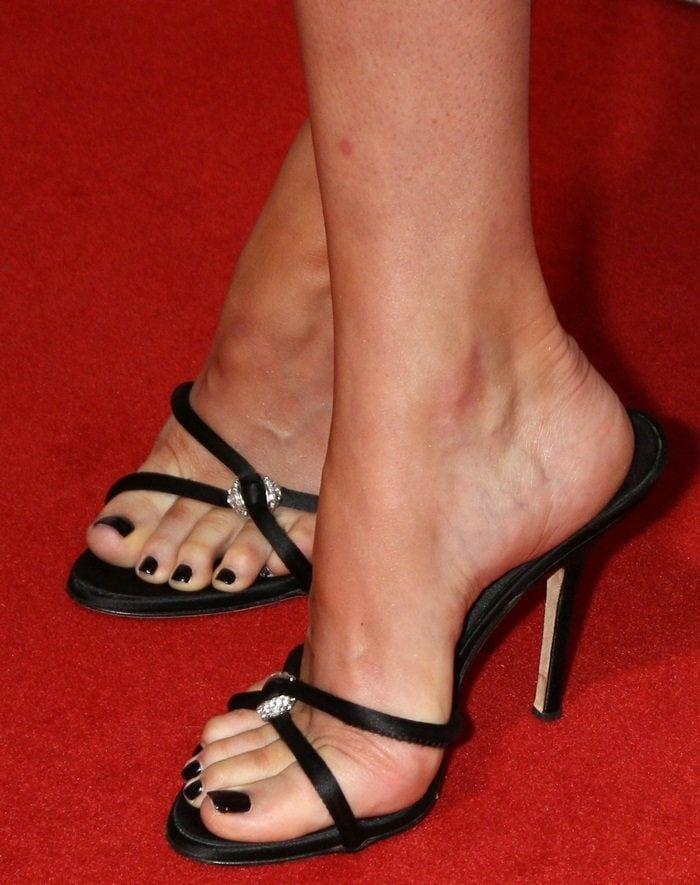 49b14e26a9345 Dakota Johnson shows off her feet in black Giuseppe Zanotti Pauline mule  sandals with crystal detail