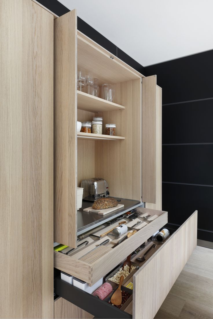 | KITCHEN | breakfast Station where countertop appliances are accessible with a work surface but can easily be closed off and hidden away when not in use. #bulthaup b3 tall storage unit with pocket doors and deep pullout with internal drawer in oak