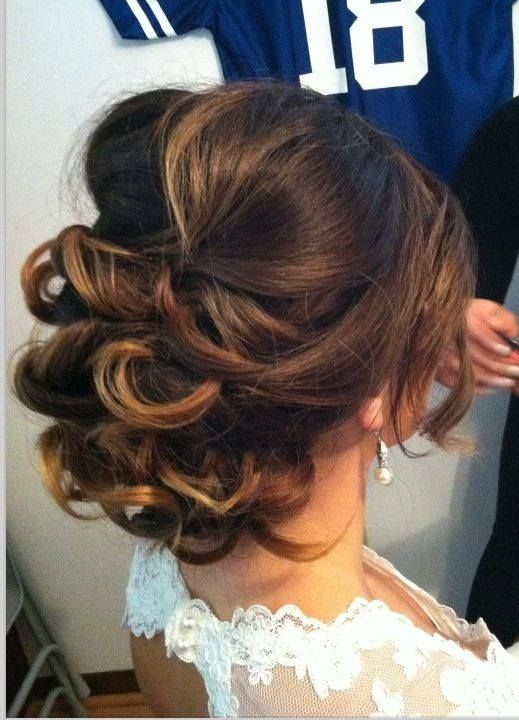 Updo, but let's be honest, I pinned for the hair and the Manning jersey in the background!  Lol
