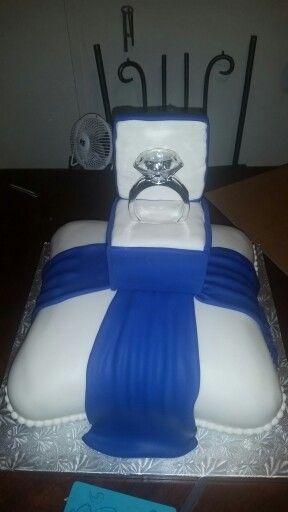 Wedding cake or engagement cake. Pillow cake white and blue