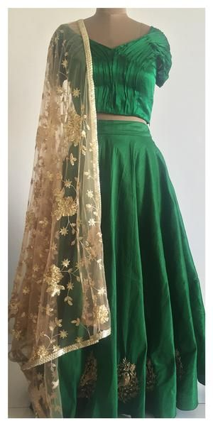 Raw silk skirt adorned with beautiful dabka, cut daana and zari hand embroidery. The set is complete with a soft net gold dupatta embellished with sequin floral embroidery.