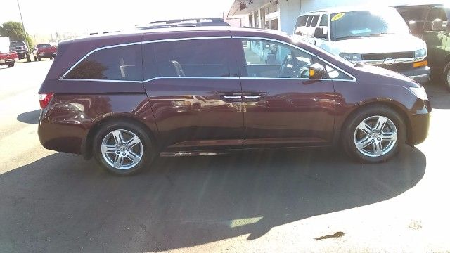 2011 Honda Odyssey Touring Minivan. Equipped with a 248hp 3.5L V6 Engine, Front Wheel Drive, Leather Seating for 8, Navigation, Sunroof, Rear DVD Entertainment System.  Landmark Auto Inc.  Smithfield, NC