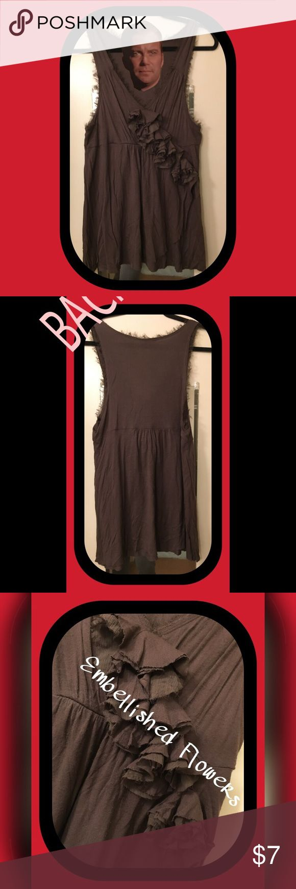 💋💋 CANDIES Low Cut Tank w/ Embellished 🌺 💋💋 💋💋 CANDIES Low Cut Tank w/ Embellished Flowers Size Large 💋💋 Dark Brown Tank Top that really makes your 'GIRLS' look AWESOME!!  Empire waist is where the flowers settle with a nice FLOW underneath.  The hem got VERY frizzle after a few washes but it kinda matches the MO of the top 🤔🤗😃 Candie's Tops Tank Tops