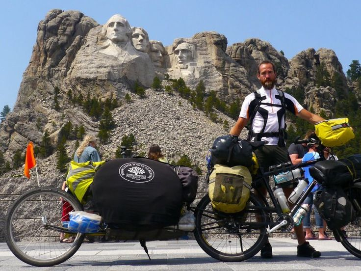 Max in front of Mount Rushmore on his way across the US