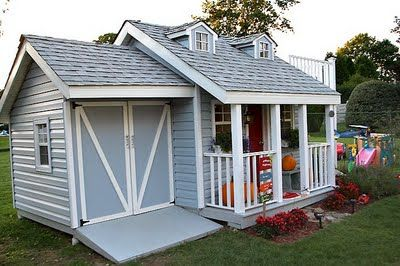THE best kids' playhouse.  I love the mini garage.  You could easily do this for cheap by repurposing a shed.