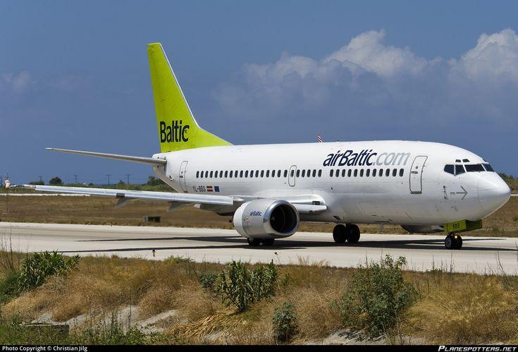 Air Baltic Boeing 737-31S YL-BBS aircraft, skating at Greece Rhodes Diagoras International Airport. July 2014.
