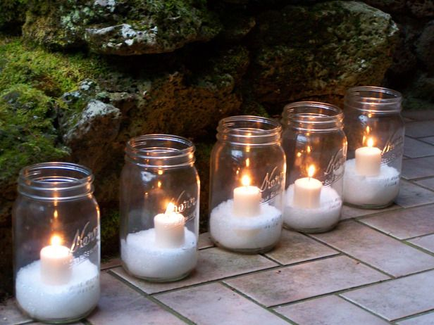 "Very good idea for decorating at Christmas time.   Fill Mason jar 1/4 to 1/2 with Epsom salt (snow) and nestle votive candle in the ""snow"".  Design by Melissa Michaels"
