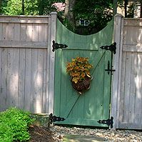 painted wooden fence gate.  Should I paint my gates like this?
