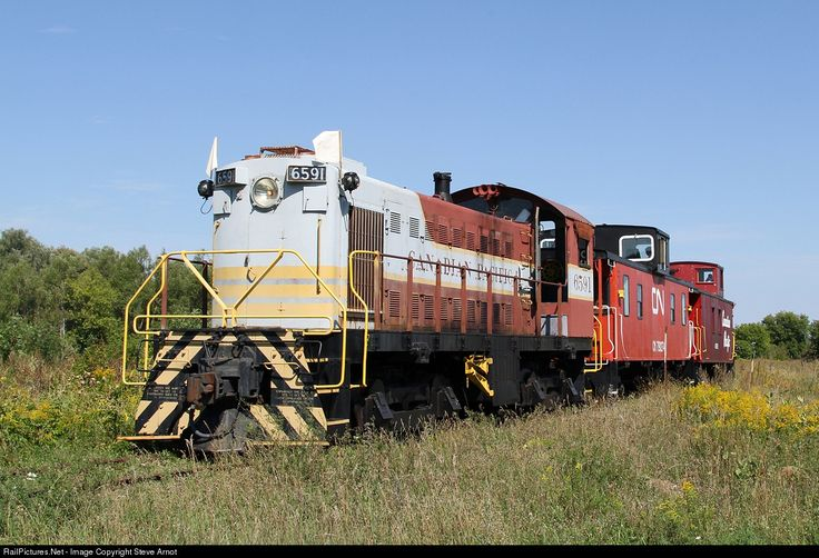 Former CP MLW S-3 6591 in operation during Trainfest at the Railway Museum of Eastern Ontario in Smiths Falls. Trailing 6591 are 1967 built ex-CN Steel Caboose #79274 and 1945 built ex-CP Wood Caboose #437183.