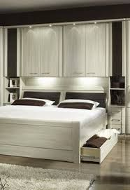 Image result for wardrobe over bed
