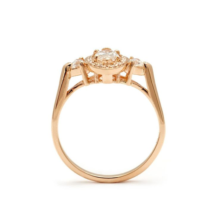 The Marquise Bea three stone engagement ring features a unique antique marquis cut champagne diamond which is set in an A.S. ceremonial jewelry signature basket