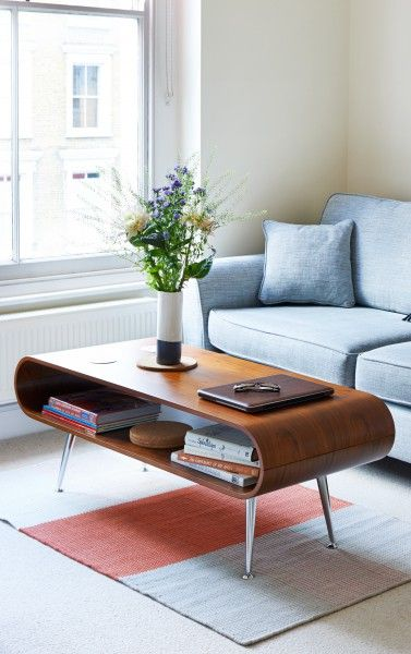 The Hooper Storage Coffee table in walnut brings instant retro style to your living room.