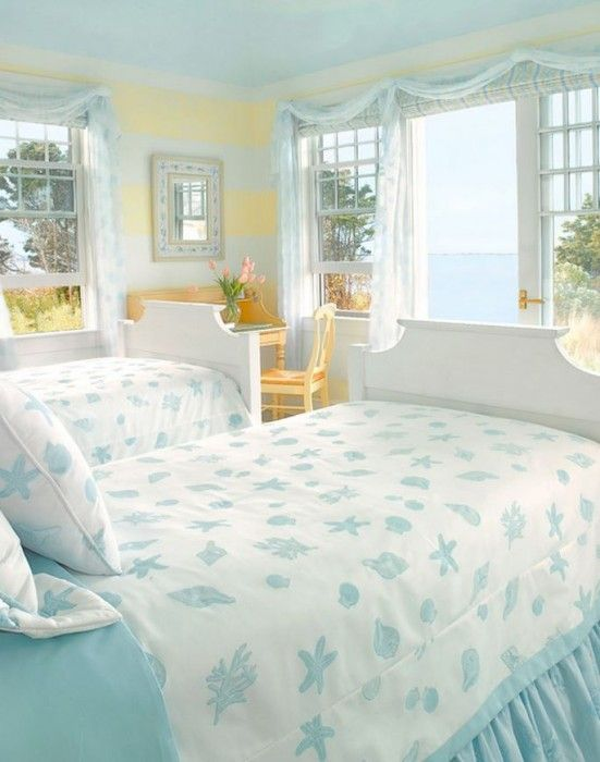 I like this and yet I don't. I love the windows and all the white and blue with the little desk, but not sure how I feel about yellow - Airy Beach Cottage Bedroom